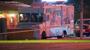 A taco truck is seen in the parking lot where a fatal shootout took place on April 19, 2016. (Credit: KTLA)
