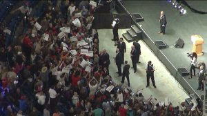 Donald Trump signs autographs for  supporters following a speech in Costa Mesa on April 28, 2016. (Credit: KTLA)