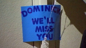 A sign for Dominick is seen during a vigil held on April 12, 2016. (Credit: KTLA)