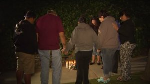 Flowers and candles mark the spot where 14-year-old Ivette Macias died in a crash on a street in Whittier on April 26, 2016. (Credit: KTLA)