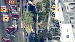 Police and firefighter respond after a man climbed the KTLA tower on May 11, 2016. (Credit: KTLA)