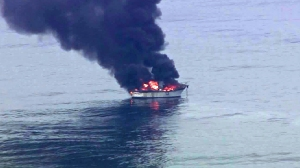 A boat was seen burning off Malibu on May 17, 2016. (Credit: KTLA)