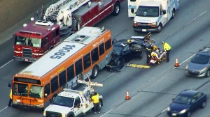 A metro bus and a car collided on the 91 Freeway on May 9, 2016. (Credit: KTLA)