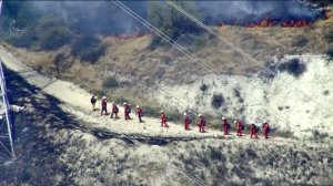 A fire crew is seen near a brush fire in Lake View Terrace on May 23, 2016. (Credit: KTLA)