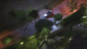 Police pursued a silver SUV before the driver slammed into a tree in Beverly Hills on May 4, 2016. (Credit: KTLA)