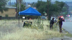 A burning body was discovered in a San Bernardino dumpster on May 20, 2016. (Credit: KTLA)