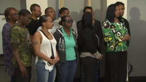 Robert Ellis' family members and supporters on May 9, 2016, await a press conference where an arrested in his killing was announced. (Credit: KTLA)