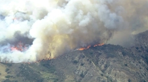 Flames burns up to ridgeline above Lake View Terrace on May 23, 2016. (Credit: KTLA)