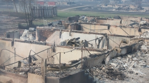 Home foundations are all that remain in a residential neighborhood destroyed by a wildfire on May 6, 2016 in Fort McMurray, Alberta, Canada Wildfires, which are still burning out of control, have forced the evacuation of more than 80,000 residents from the town. (Credit: Scott Olson/Getty Images)