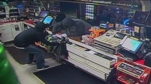 Two burglars are seen inside a liquor store on surveillance video released by the Garden Grove police Department on May 16, 2016.