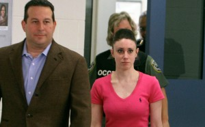 Casey Anthony, right, leaves with her attorney Jose Baez from the Booking and Release Center at the Orange County Jail after she was acquitted of killing her daughter Caylee Anthony on July 17, 2011, in Orlando, Florida. It was unknown where Casey Anthony was going after the release. (Credit: Red Huber-Pool/Getty Images)