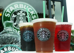 Starbucks' new iced coffee and tea beverages are displayed during a promotion July 2, 2003 outside a Starbucks coffee shop at Dupont Circle in Washington, DC. (Credit: Alex Wong/Getty Images)