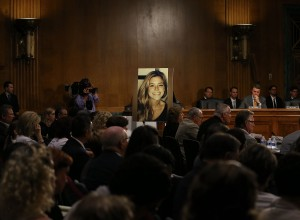 "A large photo of Kathryn ""Kate"" Steinle who was killed by an illegal immigrant in San Francisco, is shown while her dad Jim Steinle testifies during a Senate Judiciary Committee hearing on Capitol Hill, July 21, 2015 in Washington, DC. The committee heard testimony from family members who have had loved ones killed by illegal immigrants. (Credit: Mark Wilson/Getty Images)"