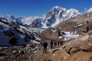 In this photograph taken on April 24, 2015, trekkers and climbers make their way up a trail leading to the village of Gorak Shep and Everest Base Camp a few days before a 7.8-magnitude quake struck on April 25, killing more than 8,800 people across the Himalayan nation and triggering a deadly avalanche on Mount Everest that killed 18 people. (Credit: ROBERTO SCHMIDT/AFP/Getty Images)