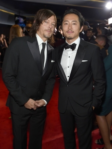 Norman Reedus, l, and Steven Yeun, r, attend AMC's 'The Walking Dead' Season 6 Fan Premiere Event 2015 at Madison Square Garden on October 9, 2015 in New York City. (Credit: Jamie McCarthy/Getty Imagesfor AMC)