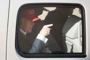 Republican presidential candidate Donald Trump gestures from his motorcade after a rally at the The Northwest Washington Fair and Event Center on May 7, 2016, in Lynden, Washington. (Credit: Matt Mills McKnight/Getty Images)
