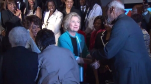 Hillary Clinton shakes hands at the California African American Museum on May 5, 2016. (Credit: KTLA)