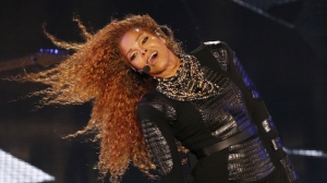 Janet Jackson performs during the Dubai World Cup horse racing event on March 26, 2016, at the Meydan racecourse in the United Arab Emirate of Dubai. Janet Jackson returned to the stage after a four-month hiatus for mysterious health reasons, bringing her energetic dance show to Dubai. (Credit: KARIM SAHIB/AFP/Getty Images)