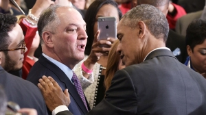 President Barack Obama greets Louisiana Governor John Bel Edwards (L) after a town hall meeting in McKinley Senior High School on January 14, 2016 in Baton Rouge, Louisiana. (Credit: MANDEL NGAN/AFP/Getty Images)
