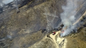 Firefighters worked to protect power lines running near a fire above Lake View Terrace on May 23, 2016. (Credit: KTLA)