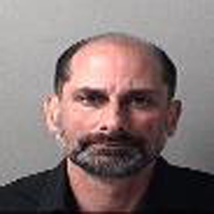 David Maloney is seen in a booking photo released by the Escambia County Jail.