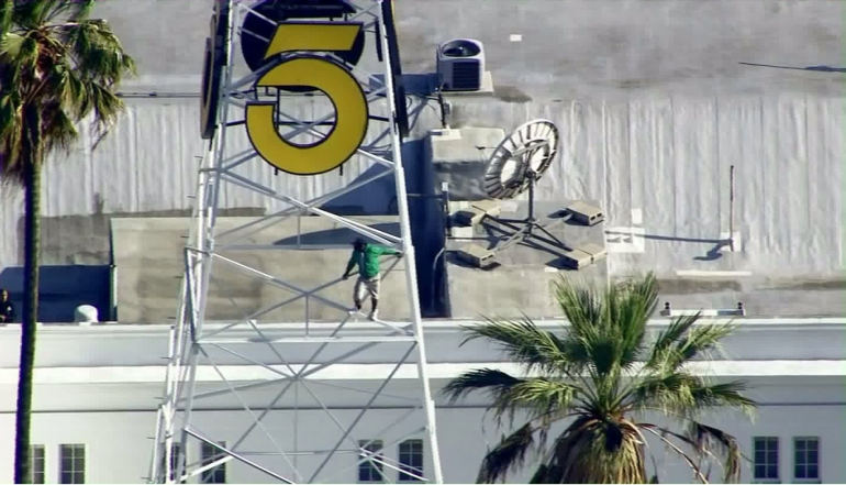 A man climbed the KTLA tower in Hollywood on May 11, 2016. (Credit: KTLA)