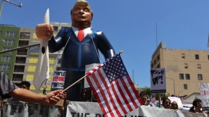 A blow up figure of Donald Trump is seen at a May Day event in downtown L.A. on May 1, 2016. (Credit: Rick Loomis / Los Angeles Times)