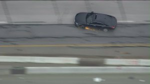 The driver lost control of his vehicle after hitting a spike strip and bouncing off the center divider in Anaheim Hills on May 5, 2016. (Credit: KTLA)