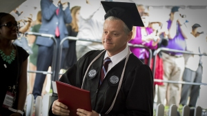 Michael Vaudreuil graduated with a mechanical engineering degree from the same place where he served as a custodian for the past eight years. (Credit: From Worcester Polytechnic Institute)