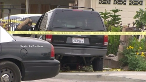 An armed man was shot by police following a pursuit in San Bernardino on May 15, 2016. (Credit: KTLA)
