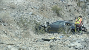A Porsche crashed some 200 feet below State Route 74 near Palm Desert on May 1, 2016, killing a baby who was inside. (Credit: KMIR)