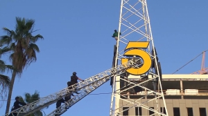 Rescuers spoke to the man more than two hours after he climbed up the KTLA tower on May 11, 2016. (Credit: KTLA