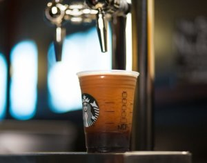 """The newest cold concoction rolling out at Starbucks this summer is the """"Nitro brew"""" -- a cold coffee infused with nitrogen and served through a beer tap. (Credit: Starbucks)"""