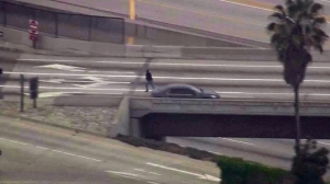 A driver flees a vehicle after spinning out in Orange County on May 17, 2016. (Credit: KTLA)