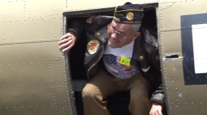 Lou Tirado emerges from a B-17 bomber in Santa Ana on May 4, 2016. (Credit: KTLA)