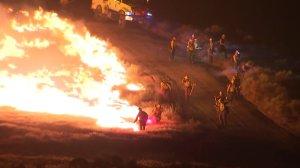 Firefighter set backfires at the end of Steve Kuzj's live shot on June 23, 2016. (Credit: KTLA)