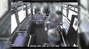 A bus driver was being called a hero after a violent attack on board her bus was caught on surveillance video. (Credit: KCPQ)