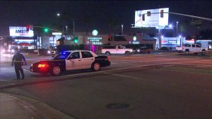 Los Angeles police responded to an intersection in Harbor City after an apparent car-to-car shooting on June 18, 2016. (Credit: KTLA)