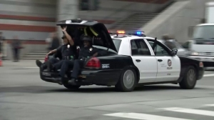 Officers were seen being transported in the trunk of a patrol car as police investigated a shooting at UCLA on June 1, 2016. (Credit: KTLA)