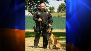 The Long Beach Police Department released this photo of Credo with his handler, Officer Mike Parcells.