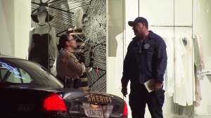 A damaged window is seen at DASH, a Kardashian owned clothing store in Beverly Grove. (Credit: KTLA)