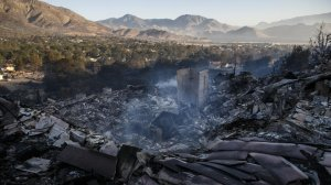 Still smoldering, smoke rises from a destroyed structure after the Erskine Fire after it tore through the Squirrel Mountain Valley neighborhood in Lake Isabella. (Credit: Marcus Yam / Los Angeles Times)