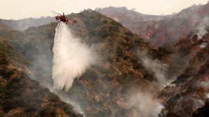 Helicopters make water drops on Spinks Canyon above Duarte Tuesday morning as two brush fires burn dangerously close to one another in Duarte and Azusa. The two fires have charred 5,400 acres. (Credit: Al Seib/Los Angeles Times)