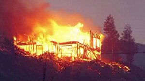 Flames from the Erskine fire tear through a house in the Lake Isabella area. (Credit: KBAK via CNN)