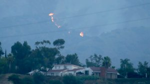 A flare up from the Fish fire can be seen in the hills abouve Duarte early Wednesday morning. (Credit: Irfan Khan/Los Angeles Times)
