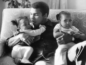 Heavyweight boxer Muhammad Ali with his daughters Laila (9 months) and Hanna (2 years 5 months) at Grosvenor House.  (Photo by Frank Tewkesbury/Evening Standard/Getty Images)