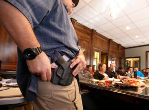 Damon Thueson shows a holster at a gun concealed carry permit class put on by 'USA Firearms Training' on December 19, 2015 in Provo, Utah. (Credit: George Frey/Getty Images)