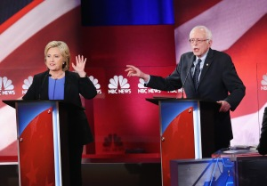 Former Secretary of State Hillary Clinton and Sen. Bernie Sanders participate in a debate hosted by NBC News and YouTube on Jan. 17, 2016, in Charleston, South Carolina. (Credit: Andrew Burton/Getty Images)