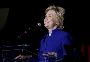"Democratic presidential candidate Hillary Clinton speaks on stage during the ""Hillary Clinton: She's With Us"" concert at The Greek Theatre on June 6, 2016, in Los Angeles. (Credit: Kevin Winter/Getty Images)"