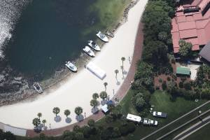 Search and rescue boats are seen on a beach near the Walt Disney World's Grand Floridian resort hotel where a 2-year-old boy was taken by an alligator as he waded in the waters of the Seven Seas Lagoon on June 15, 2016. (Credit: Joe Raedle/Getty Images)